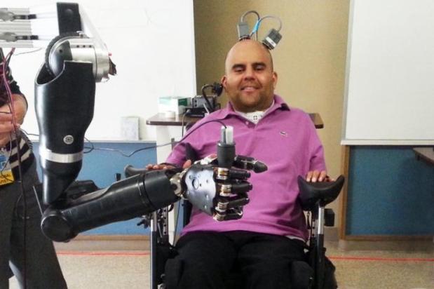 Erik Sorto controlling the robotic arm with his mind