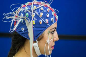 [EEG cap on woman]