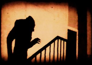 Shadow of hunchback walking up stairs
